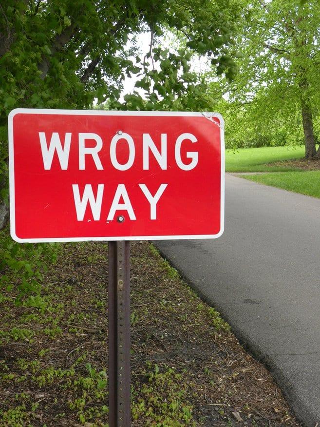 street sign - wrong way